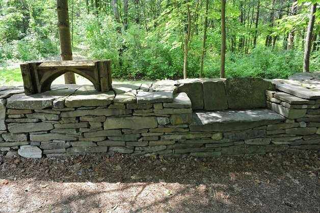 Built in bench in stone wall with archway on Thom Breitenbach's property where he owns a castle he's made out of local stone which is also a wedding venue on Monday, Aug. 17, 2015 in Altamont, N.Y. He is also an artist and plans to leave the castle and his paintings as a museum when he dies. (Lori Van Buren / Times Union) Photo: Lori Van Buren / 00032981A
