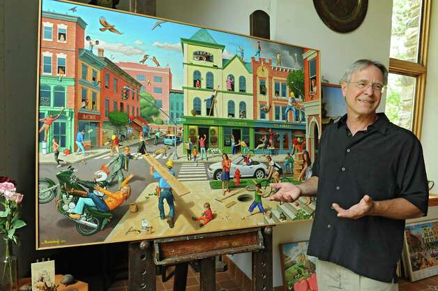 """Thom Breitenbach stands next to one of his proverbidioms paintings """"Accidents Waiting To Happen"""" in his castle he's made out of local stone on Monday, Aug. 17, 2015 in Altamont, N.Y. The castle is now a wedding venue. He plans to leave the castle and his paintings as a museum when he dies. (Lori Van Buren / Times Union) Photo: Lori Van Buren / 00032981A"""