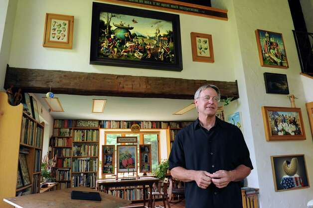 Thom Breitenbach stands among his proverbidioms paintings in his castle he's made out of local stone on Monday, Aug. 17, 2015 in Altamont, N.Y. The castle is now a wedding venue. He plans to leave the castle and his paintings as a museum when he dies. (Lori Van Buren / Times Union) Photo: Lori Van Buren / 00032981A