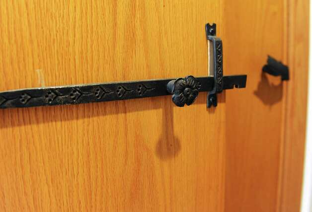 Detail of door hardware made by Thom Breitenbach in his Castle he's made from local stone  on Monday, Aug. 17, 2015 in Altamont, N.Y. The castle is now a wedding venue. He plans to leave the castle and his paintings as a museum when he dies. (Lori Van Buren / Times Union) Photo: Lori Van Buren / 00032981A