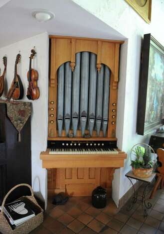 Built-in organ in Thom Breitenbach castle he's made out of local stone on Monday, Aug. 17, 2015 in Altamont, N.Y. The castle is now a wedding venue. He plans to leave the castle and his paintings as a museum when he dies. (Lori Van Buren / Times Union) Photo: Lori Van Buren / 00032981A