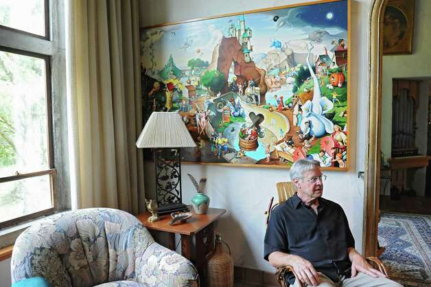 Thom Breitenbach sits under one of his proverbidioms paintings in his castle he's made out of local stone on Monday, Aug. 17, 2015 in Altamont, N.Y. The castle is now a wedding venue. He plans to leave the castle and his paintings as a museum when he dies. (Lori Van Buren / Times Union) Photo: Lori Van Buren / 00032981A