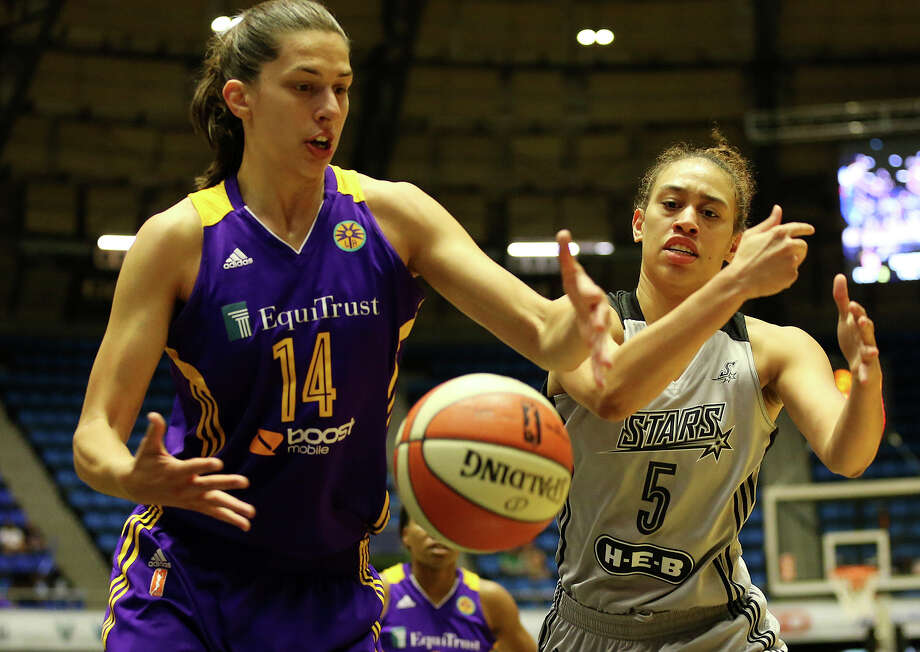 Los Angeles Sparks' Marianna Tolo and San Antonio Stars' Dearica Hamby can't get their hands on a rebound during the first half at the Freeman Coliseum, Sunday, August 23, 2015. Photo: JERRY LARA, Staff / San Antonio Express-News / © 2015 San Antonio Express-News