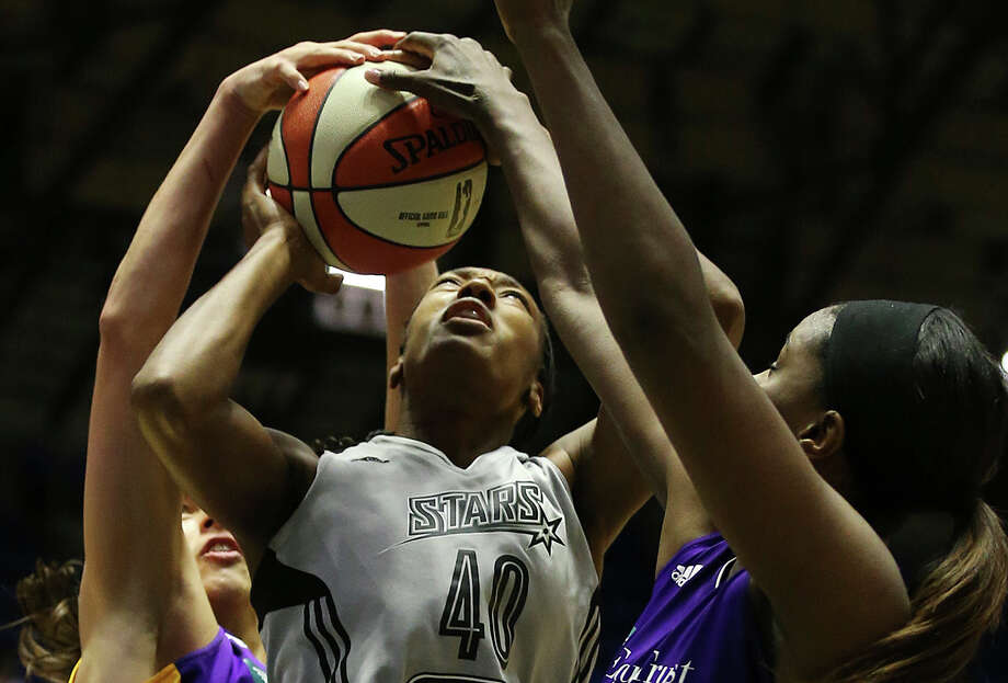 The Stars' Kayla Alexander is surrounded by Sparks during the second half of a blowout loss at Freeman Coliseum. Photo: Jerry Lara / San Antonio Express-News / © 2015 San Antonio Express-News