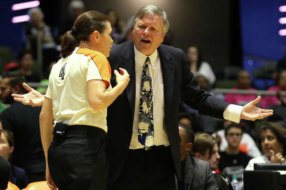 San Antonio Stars head coach Dan Hughes argues a call with official Sue Blauch during the second half at Freeman Coliseum against the Los Angeles Sparks on Aug. 23, 2015. Photo: Jerry Lara /San Antonio Express-News / © 2015 San Antonio Express-News