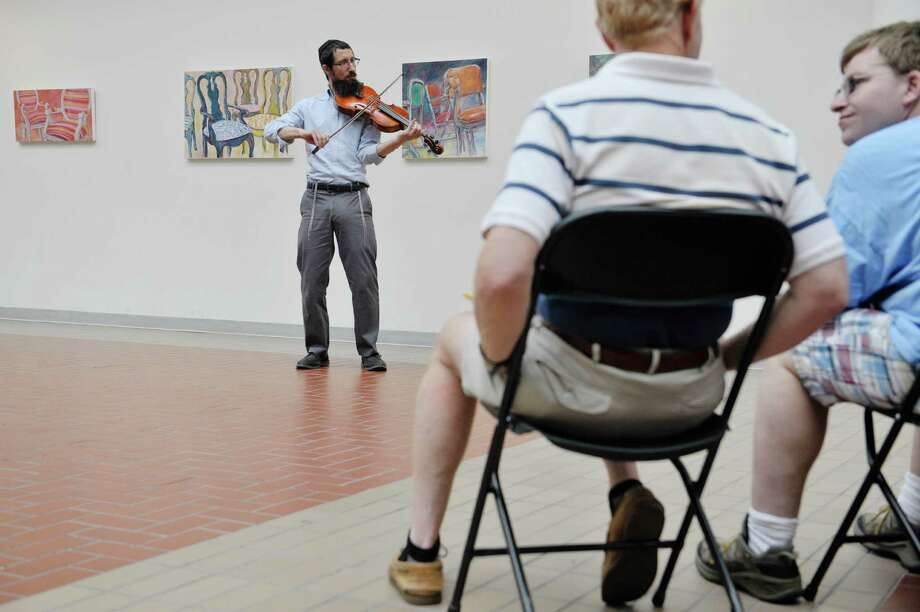 Yehoshua Sussman of Albany plays the violin at the OTo LifeO Festival put on by the Beth-Tephilah Synagogue at the Troy Atrium on Sunday, Aug. 23, 2015, in Troy, N.Y.  The event featured Jewish ethnic foods, music and talks on the religion and culture.    (Paul Buckowski / Times Union) Photo: PAUL BUCKOWSKI / 00033019A