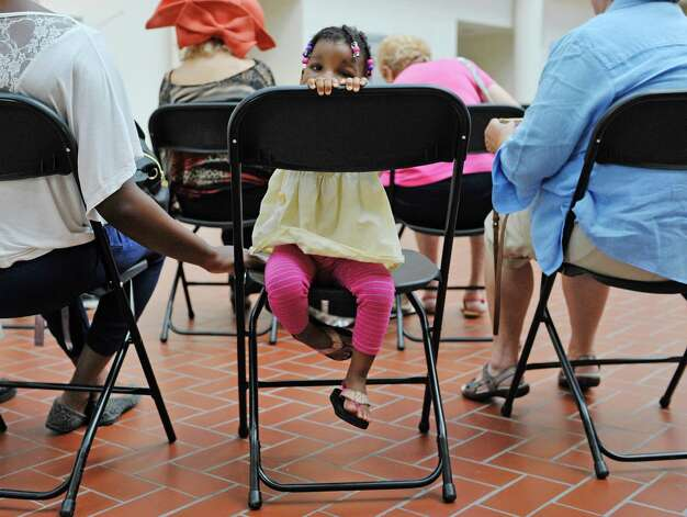 Amara Ware, 2, of Troy spins around in her chair as she listens to music at the OTo LifeO Festival put on by the Beth-Tephilah Synagogue at the Troy Atrium on Sunday, Aug. 23, 2015, in Troy, N.Y.  The event featured Jewish ethnic foods, music and talks on the religion and culture.    (Paul Buckowski / Times Union) Photo: PAUL BUCKOWSKI / 00033019A