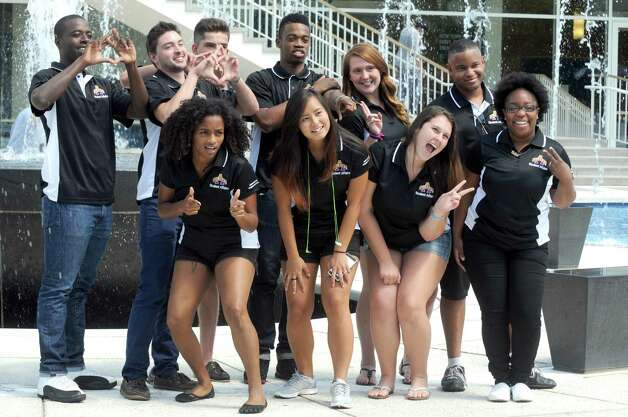 UAlbany's new off-campus student ambassadors pose for a group photograph in front of the fountain at the UAlbany Campus Center on Friday Aug. 21, 2015 in Albany, N.Y.  (Michael P. Farrell/Times Union) Photo: Michael P. Farrell / 00033049A