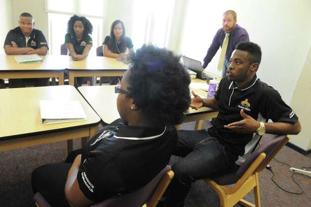 Khari Shabazz, right, joins fellow UAlbany's new off-campus student ambassadors as they talk about their community relation plans at the UAlbany Campus Center on Friday Aug. 21, 2015 in Albany, N.Y.  (Michael P. Farrell/Times Union) Photo: Michael P. Farrell / 00033049A
