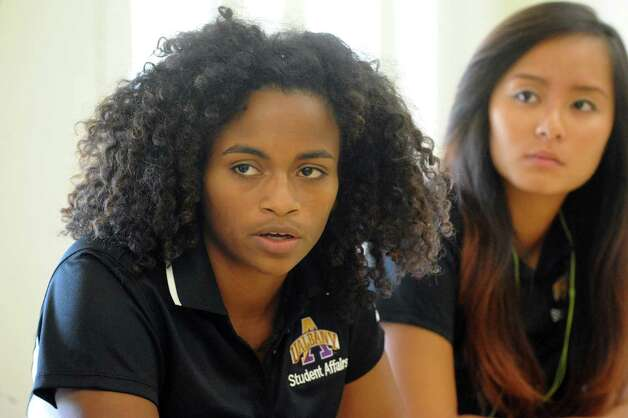 Rebecca Marimutu, left, joins fellow UAlbany's new off-campus student ambassadors as they talk about their community relation plans at the UAlbany Campus Center on Friday Aug. 21, 2015 in Albany, N.Y.  (Michael P. Farrell/Times Union) Photo: Michael P. Farrell / 00033049A