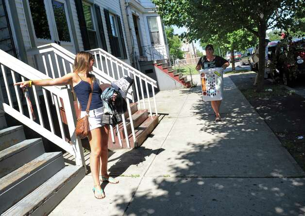 UAlbany junior Sara Catalano, left, gets help from her parents Christine and T.C. Catalano moving into her Hamilton Street aprtment on Saturday Aug. 22, 2015 in Albany, N.Y.  (Michael P. Farrell/Times Union) Photo: Michael P. Farrell / 00033083A