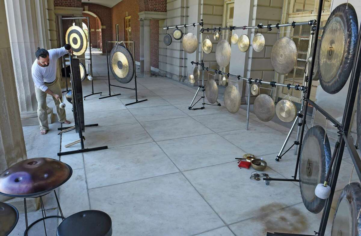 FILE - Jim Pavoldi plays a gong at the gong bath at the Roosevelt II Bath House at the Saratoga State Park Aug. 23, 2015 in Saratoga Springs, N.Y. (Skip Dickstein/Times Union)