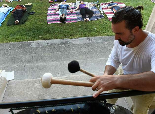 Jim Pavoldi plays a gong at the gong bath at the Roosevelt II Bath House at the Saratoga State Park  Aug. 23, 2015 in Saratoga Springs, N.Y.      (Skip Dickstein/Times Union) Photo: SKIP DICKSTEIN / 00033077A