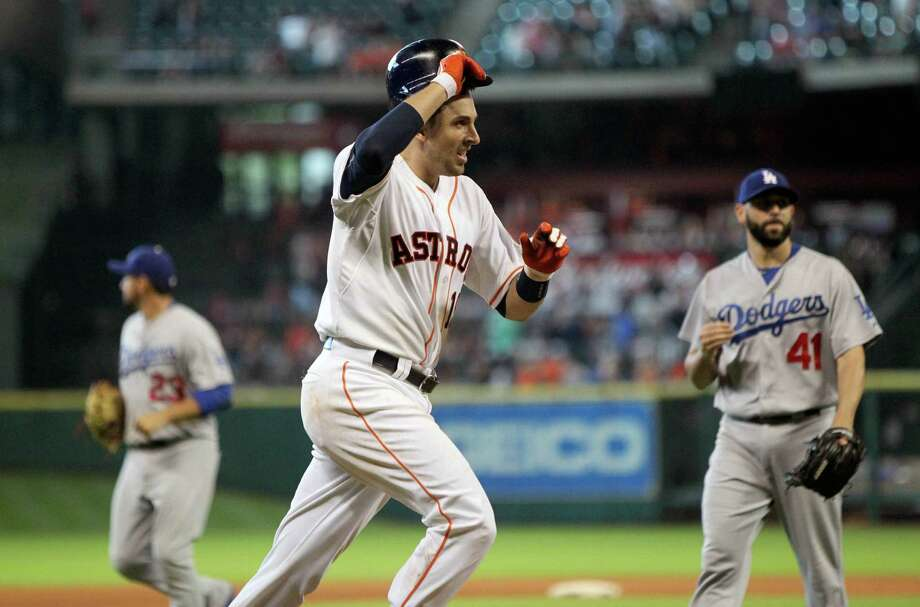 Houston Astros catcher Jason Castro (15) hits a walk off home run against Los Angeles Dodgers relief pitcher Chris Hatcher (41) in the bottom of the tenth inning in the Astros 3-12 winn in a baseball game played at Minute Maid Park Sunday, Aug. 23, 2015, in Houston. ( Gary Coronado / Houston Chronicle ) Photo: Gary Coronado, Staff / © 2015 Houston Chronicle