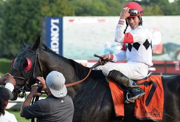 Jockey Irad Ortiz Jr. continues his winning ways with a big smile after winning the 2nd running of The Tale of the Cat Stake aboard Stallwalkin' Dude at the Saratoga Race Course Sunday afternoon  Aug. 23, 2015 in Saratoga Springs, N.Y.      (Skip Dickstein/Times Union) Photo: SKIP DICKSTEIN