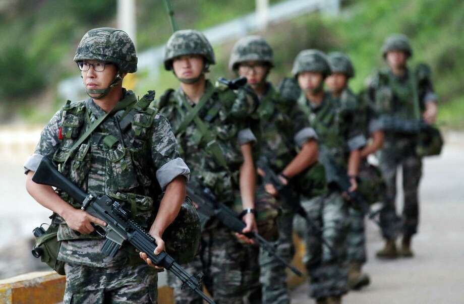 South Korean marines patrol along on Yeonpyeong island, South Korea, Sunday, Aug. 23, 2015. Senior officials from North and South Korea resumed a second round of talks on Sunday that temporarily pushed aside vows of imminent war on the peninsula.  South Korea's presidential office said the talks restarted in the border village of Panmunjom.  The delegates failed to reach an agreement in Saturday's marathon talks that stretched into the early hours of Sunday, and it was still unclear whether diplomacy would defuse what has become the most serious confrontation in years. (Yun Tae-hyun/Yonhap via AP) KOREA OUT Photo: Yun Tae-hyun, SUB / Yonhap