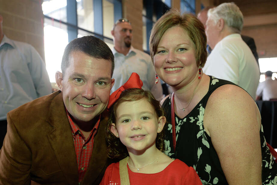 Ben Beasley, Sarah Beasely, 6, and Ellen Beasley during Lamar's football banquet at Ford Park Sunday night.  Photo taken Sunday, August 23, 2015 Guiseppe Barranco/The Enterprise Photo: Guiseppe Barranco, Photo Editor