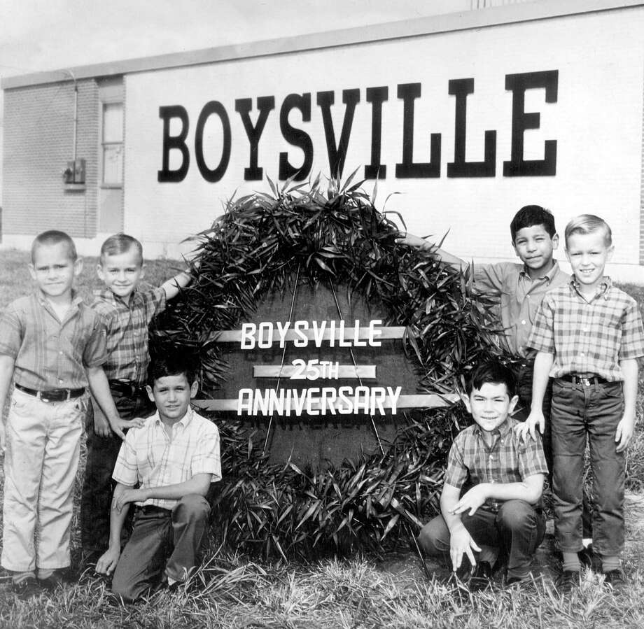 Six young boys are positioned around a sign proclaiming the 25th anniversary of Boysville in a June 12, 1968, photo. Photo: Express-News File Photo / SAN ANTONIO EXPRESS-NEWS FILES