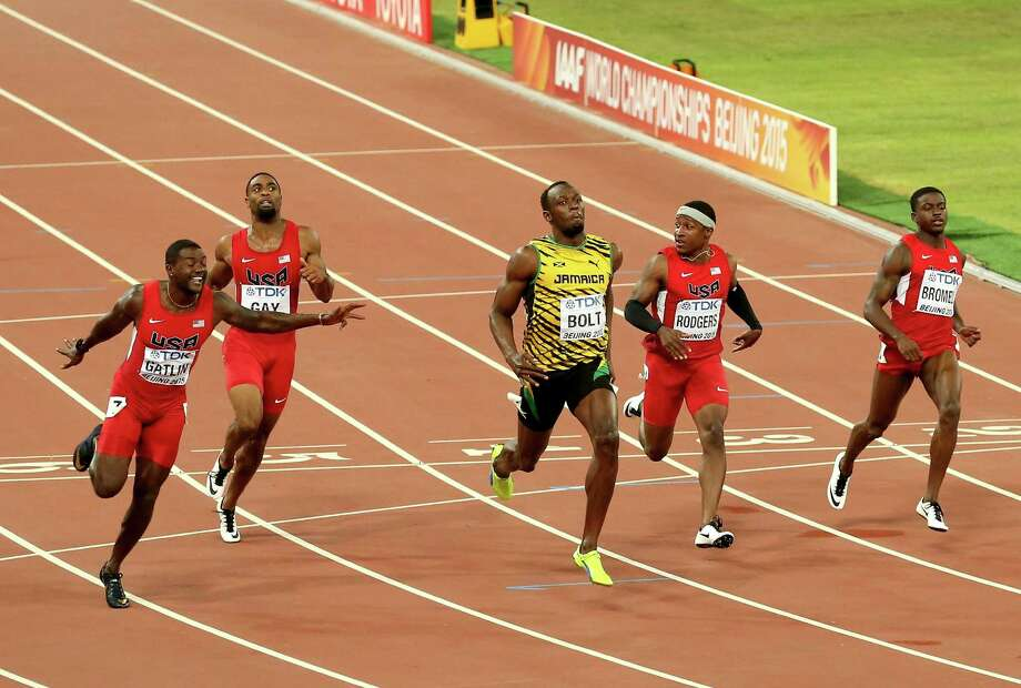 Jamaica's Usain Bolt, center, crosses the finish line ahead of a quartet of American sprinters - Justin Gatlin (second), Tyson Gay (sixth), Mike Rodgers (fifth) and Trayvon Bromell (tie for third) - to win the 100 meters. Photo: Maxx Wolfson, Staff / 2015 Getty Images