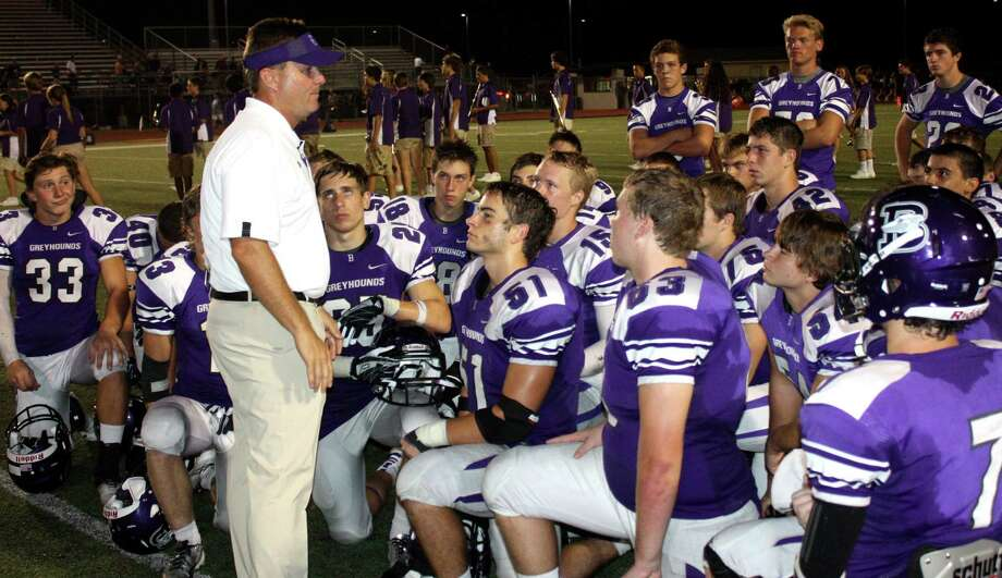 Boerne coach Mike Dormady talks to his Greyhounds players a mistake-filled loss to the Hondo Owls in 2013. Photo: Express-News File Photo