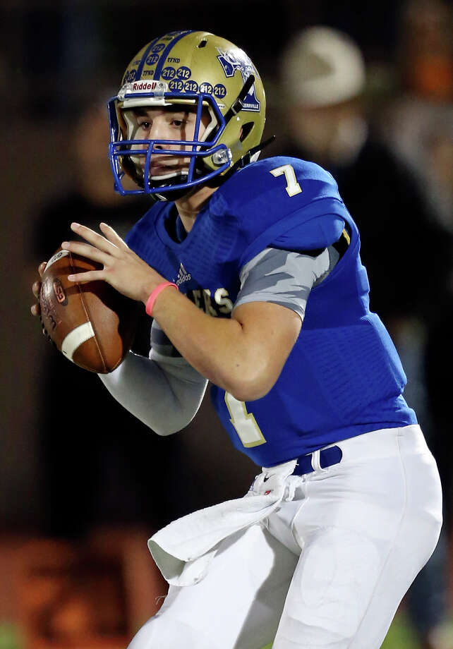 Kerrville Tivy's Cade Dyal looks to pass against Cedar Park during first half action of their Class 5A Division II state quarterfinal playoff game Friday Dec. 5, 2014 at Alamo Stadium. Photo: Edward A. Ornelas /San Antonio Express-News / © 2014 San Antonio Express-News