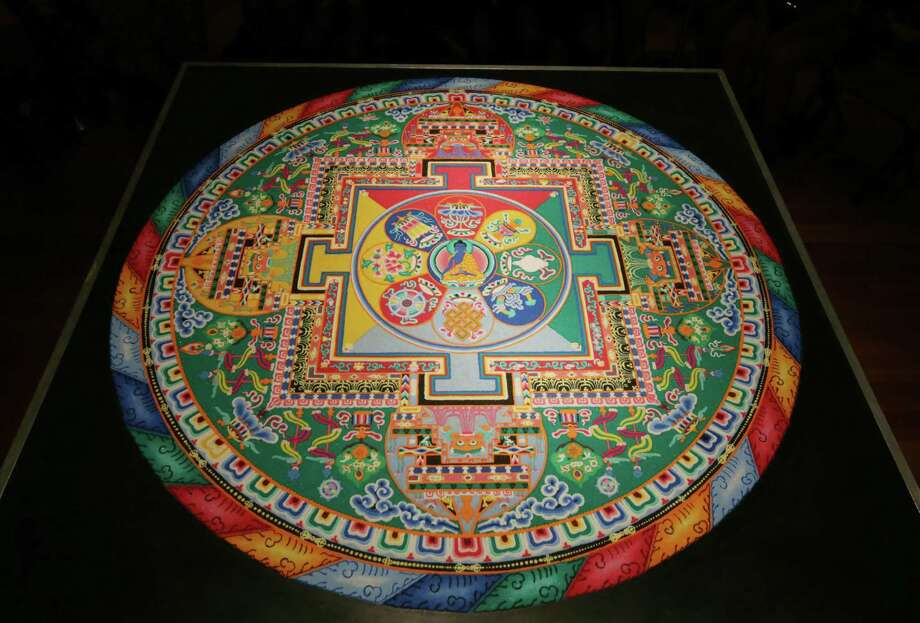 The  finished mandala sand painting, created by monks from India, waits for the sweeping ceremony. Photo: Jon Shapley, Staff / © 2015 Houston Chronicle