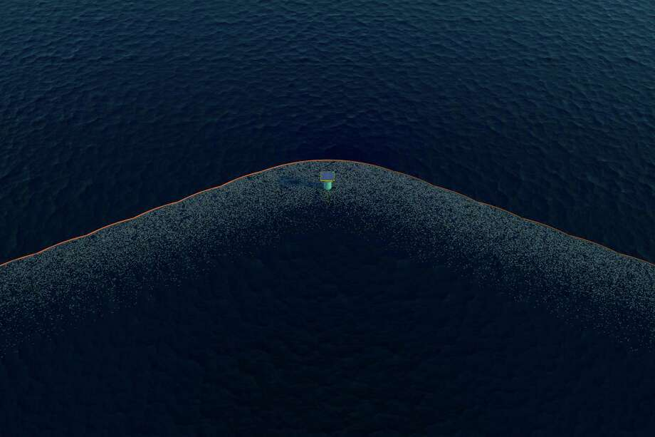 This computer-generated artists' illustration provided by The Ocean Cleanup shows how a floating barrier and collection station might appear in a project to collect plastic garbage from the world's oceans. A team of researchers, sponsored by The Ocean Cleanup, an organization founded by 21-year-old innovator from the Netherlands, are studying the plastic waste in an effort to eventually clean up what's known as the Great Pacific Garbage Patch. (Erwin Zwart/The Ocean Cleanup via AP) Photo: Erwin Zwart, HONS / Associated Press / The Ocean Cleanup