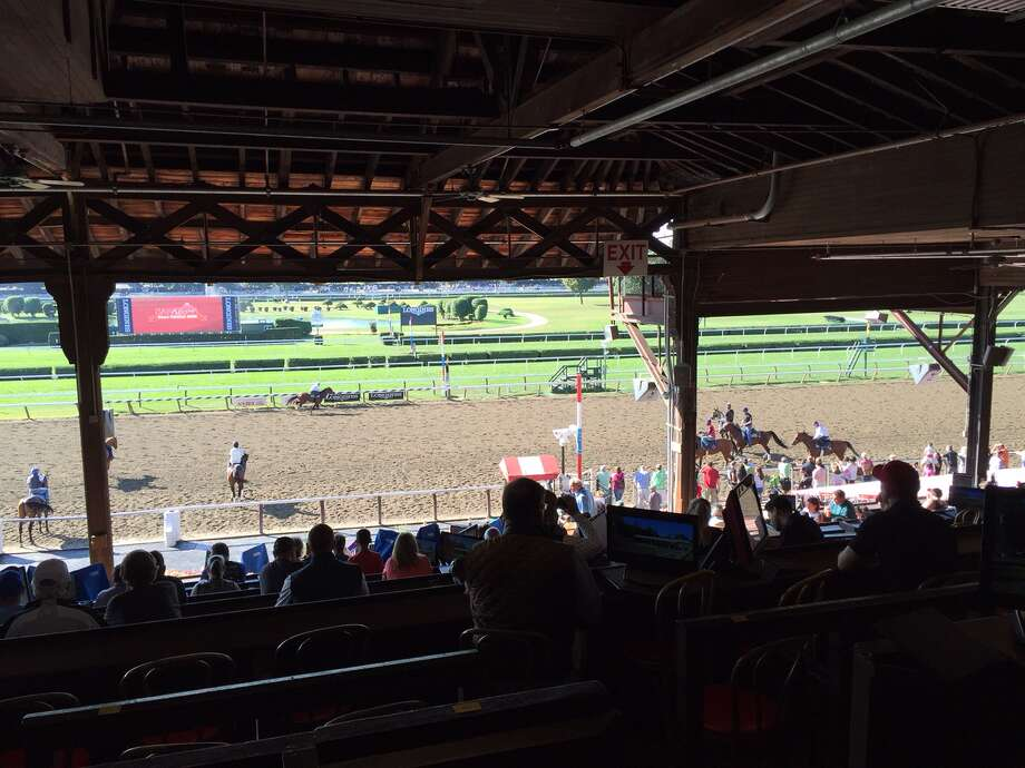 Another glorious morning at the most beautiful race track in all the land (but Santa Anita gives it a run for its money) brought plenty of people out to sit in the high-priced box seats to watch the morning workouts on Sunday. Coffee and a bagel with your horses? Why not. But, all you fans of this place, take note. The 40-day meet ends two weeks from today. Still some time to swing by and soak in some Saratoga. (Tim Wilkin / Times Union)