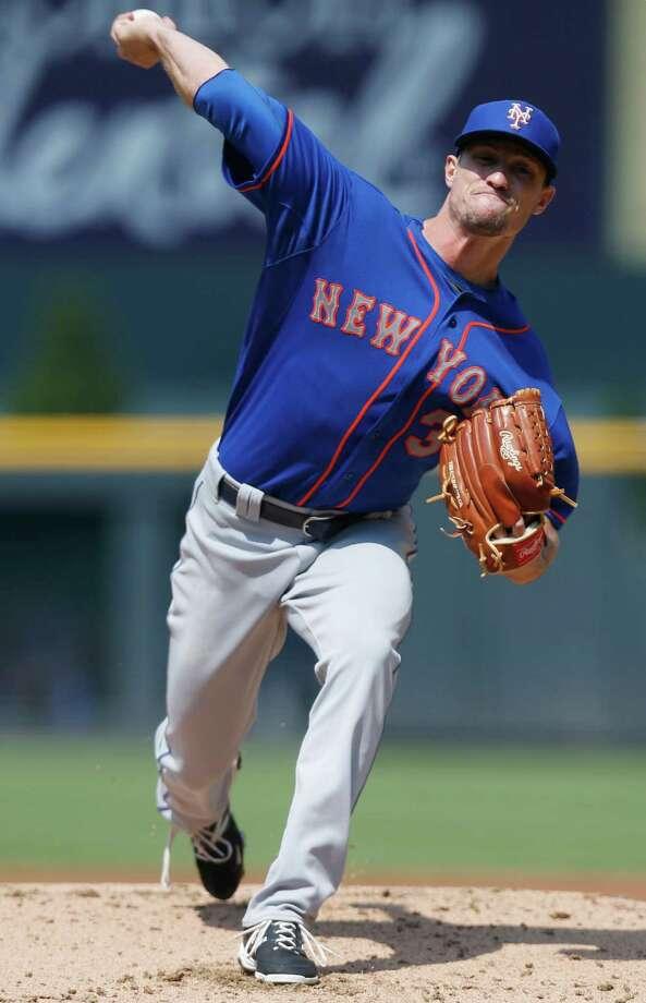 New York Mets starting pitcher Logan Verrett works against the Colorado Rockies during the first inning of a baseball game Sunday, Aug. 23, 2015, in Denver. (AP Photo/David Zalubowski) ORG XMIT: CODZ107 Photo: David Zalubowski / AP