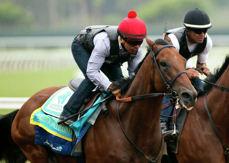 Triple Crown winner American Pharoah and jockey Martin Garcia appear during a workout, Sunday Aug. 23, 2015 at Del Mar Thoroughbred Club in Del Mar, Calif. American Pharoah will run next in the Travers Stakes at a sold-out Saratoga Race Course on Saturday. (Benoit Photo via AP) ORG XMIT: NY112 / Benoit Photo