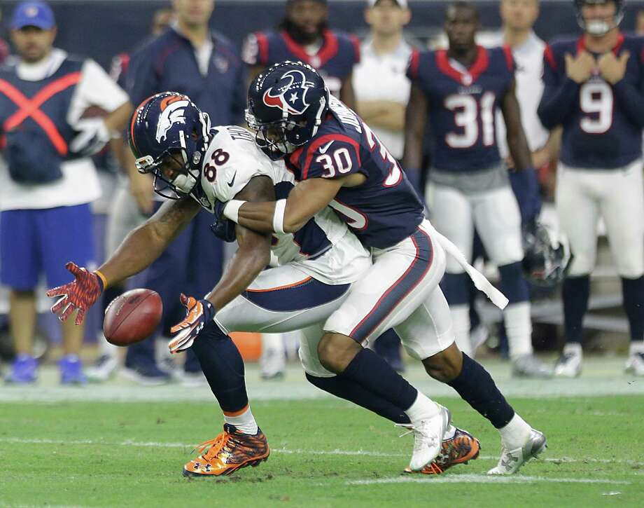 Broncos wide receiver Demaryius Thomas (88) wasn't able to have his way against Texans cornerback Kevin Johnson during Saturday night's game. Photo: Brett Coomer, Staff / © 2015  Houston Chronicle