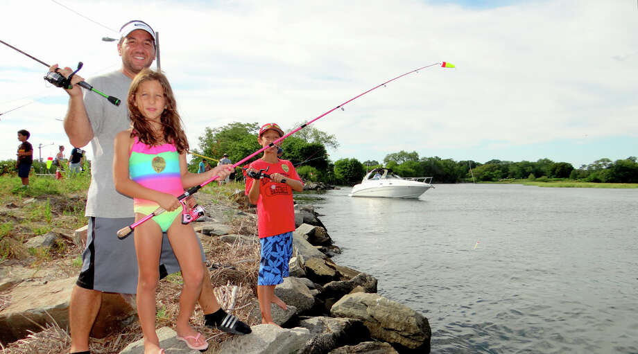 Matt Vivona of Fairfield fishes with his daughter, Mia, 7, and son, Matt, 11, at Fairfield PAL's Blues Fishing Derby on Saturday afternoon at South Benson Marina. Photo: Mike Lauterborn / For Hearst Connecticut Media / Fairfield Citizen