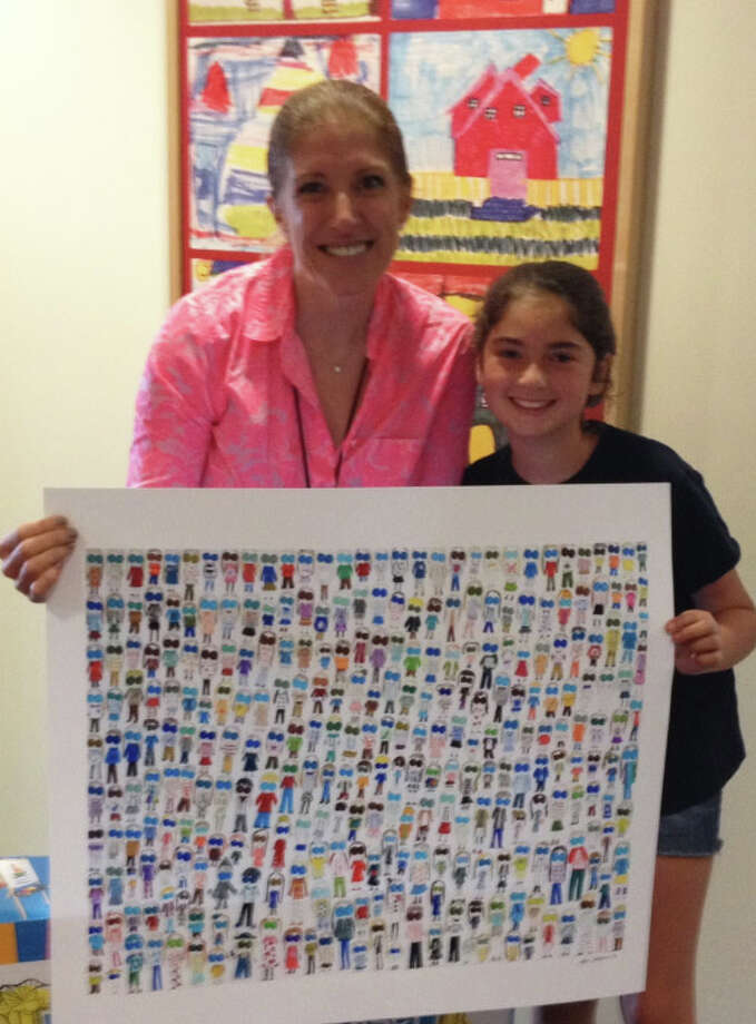 "Jane Krauss, right, and Kristen Tomasiewicz, director of community services at Kids in Crisis, displaying a print of ""Jane's People."" Jane has raised money from her artwork to purchase art supplies for children at the crisis center. Photo: Contributed / Contributed Photo / Westport News"
