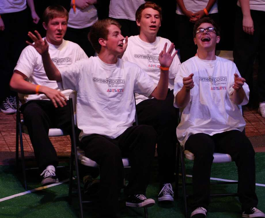 Representing Faith West Academy in front, from left, are: Brian Bulkley and J.T. Heilander, and in back, Ben Bray and Lukas Kontilis perform in last year's ComedySportz High School League's regional competition.