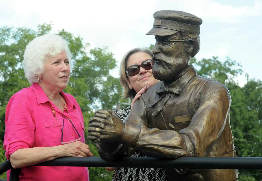 Ken Walden's sister, Karen Perkovich, of Spring 77379, and Tomball mayor Gretchin Fagin admire the sculpture during the dedication of the Ken Walden sculpture at the Tomball Railroad depot in downtown Tomball. Walden was a longtime volunteer at the depot. Photograph by David Hopper. Photo: David Hopper, Freelance / freelance