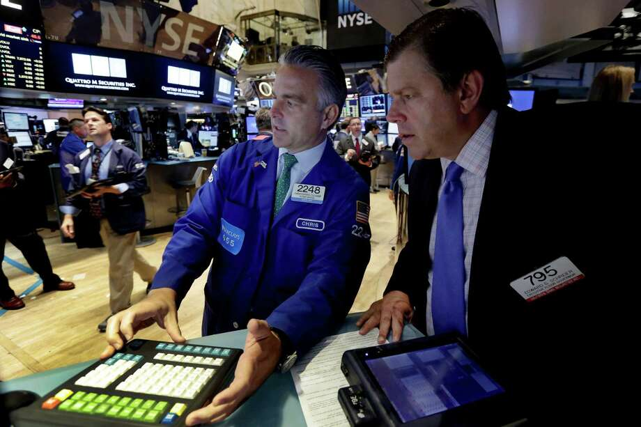 Specialist Christopher Culhane, center, and trader Edward Schreier, right, work on the floor of the New York Stock Exchange, Monday, Aug. 24, 2015. U.S. stock markets plunged in early trading Monday following a big drop in Chinese stocks. Photo: Richard Drew /Associated Press / AP