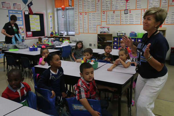First grade teacher Sonia Ray (right) greets her students Monday August 24, 2015 on the first day of school at the brand new Cibolo Valley Elementary School in the Schertz-Cibolo-Universal City Independent School District.