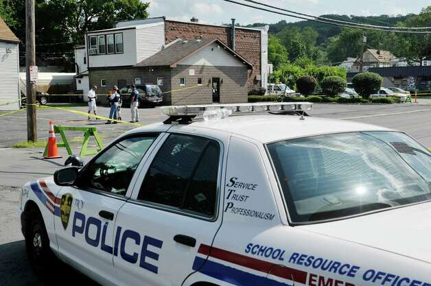 Investigators work at the scene near the corner of 112th St. and East Park Place on Monday, Aug. 24, 2015, in Troy, N.Y.  Two Troy police offices, Joshua Comitale and Chad Klein were shot in this area during an incident with a suspect late Saturday night.  (Paul Buckowski / Times Union) Photo: PAUL BUCKOWSKI / 00033100A