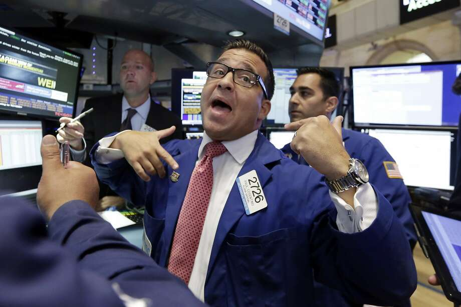 Specialist Paul Cosentino, center, works at his post on the floor of the New York Stock Exchange, Monday, Aug. 24, 2015. U.S. stock markets plunged in early trading Monday following a big drop in Chinese stocks.   Photo: Richard Drew, Associated Press