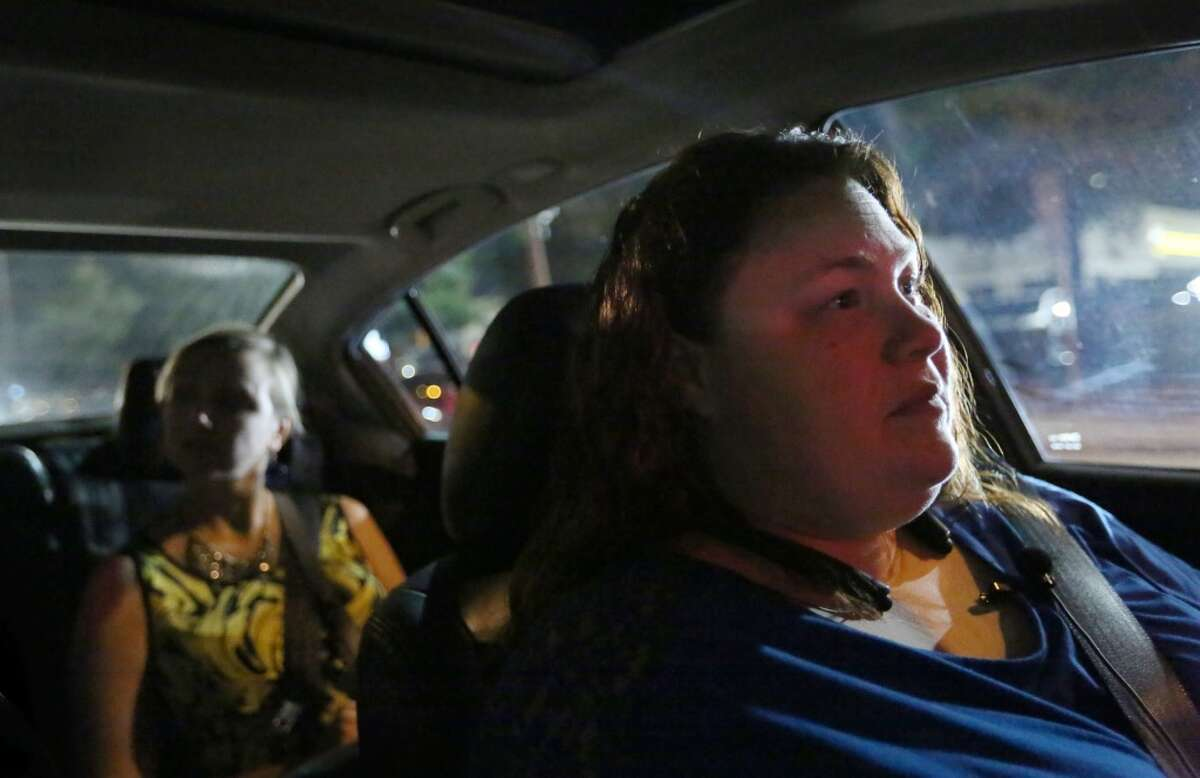 Shirley Fuller drives Jen Smith and her husband Rob, not pictured, during a shift for Uber Friday, Aug. 7, 2015, in Houston. Fuller was laid off from her job at a valve manufacturing company March 25. She is one of a growing number of people who struggle to earn enough money as low oil prices push energy companies to lay off workers. ( Jon Shapley / Houston Chronicle )