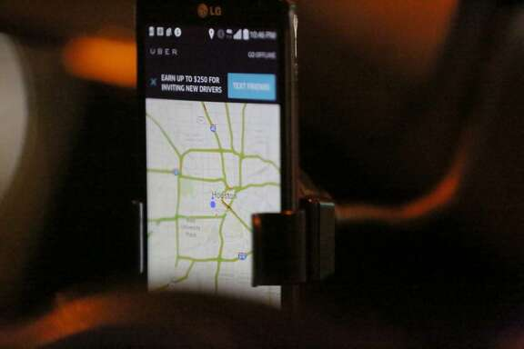 The Uber app is seen as Shirley Fuller drives during her shift Friday, Aug. 7, 2015, in Houston. Fuller was laid off from her job at a valve manufacturing company March 25. She is one of a growing number of people who struggle to earn enough money as low oil prices push energy companies to lay off workers. ( Jon Shapley / Houston Chronicle )