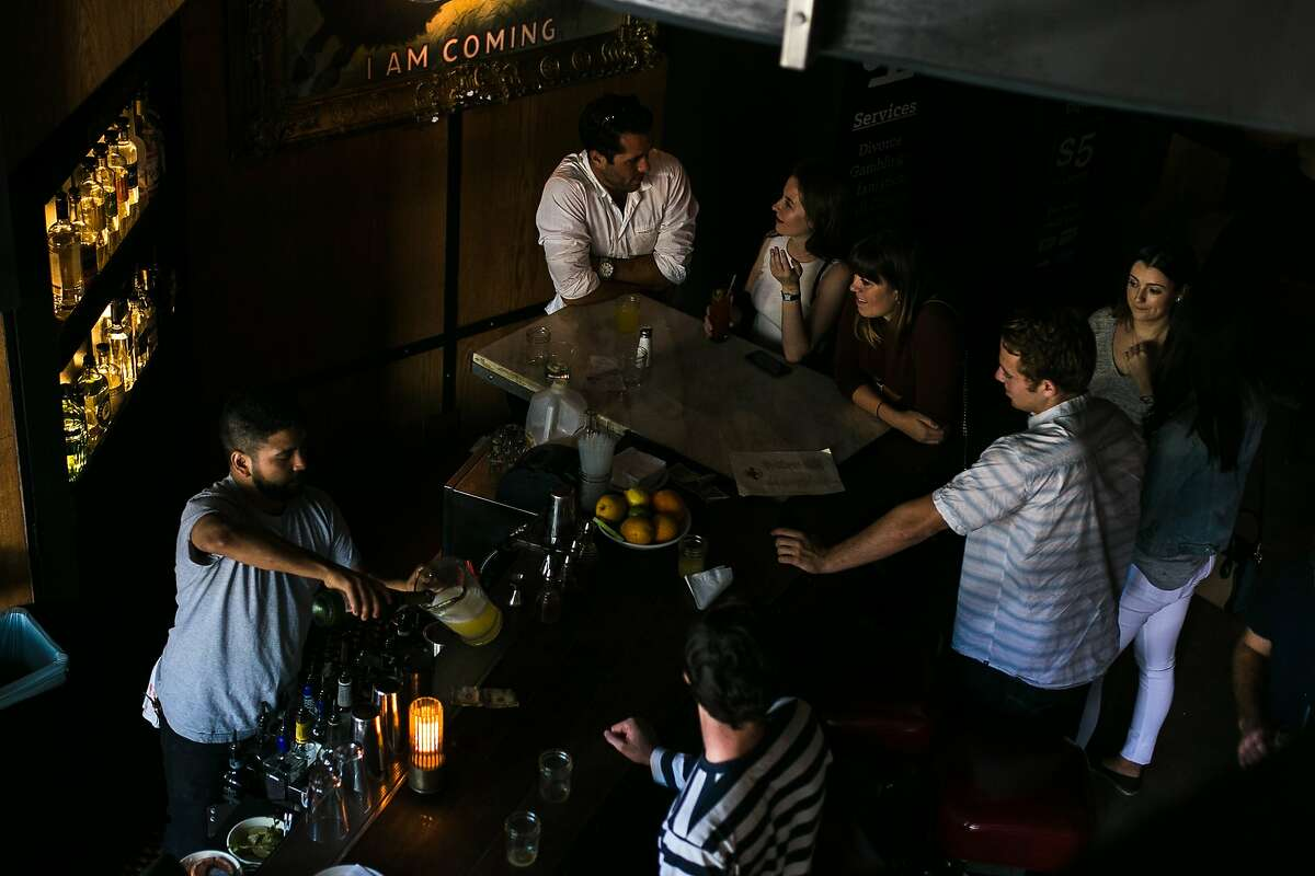 Bartender Jeff Wiant serves up pitchers of mimosas at Cease and Desist in the Mission for FOB Kitchen's brunch pop up.