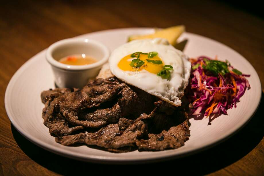 A fried egg crowns a traditional Filipino meat dish at FOB Kitchen's brunch at Cease and Desist in the Mission. Photo: Jen Fedrizzi, Special To The Chronicle