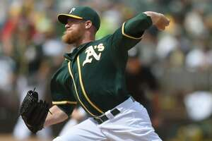 A's reliever Sean Doolittle waits, works - Photo