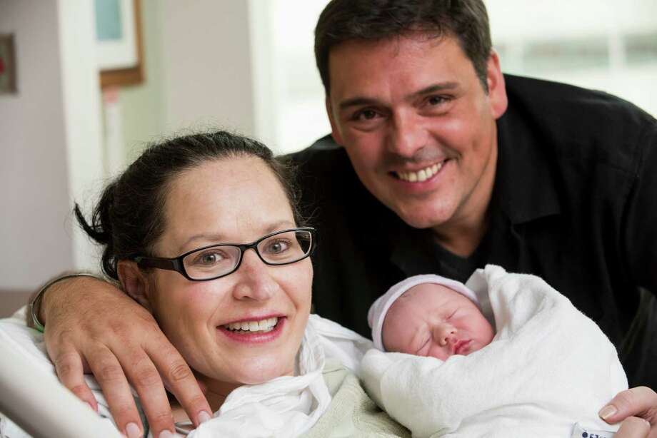 Stephanie Tallent and Jason Nece were married Aug. 21, 2015, at Texas Children's Pavilion for Women In Houston, while Tallent was in labor. Their daughter, Sophia, was born shortly after the wedding ceremony, organized by hospital staff. Photo: Allen Kramer, Texas Children's Pavilion For Women / Texas Children's Hospital