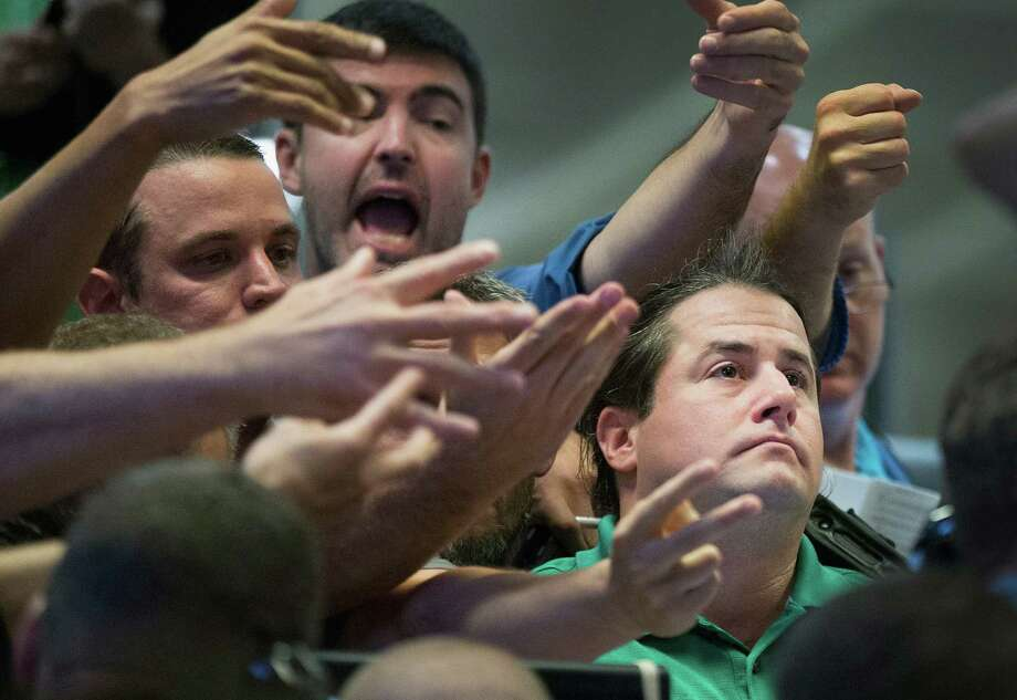 Traders signal offers in the Standard & Poor's 500 stock index options pit at the Chicago Board Options Exchange (CBOE) on August 24, 2015 in Chicago, Illinois. Uncertainty among traders after big losses in the Asian markets caused a sharp drop in the S&P at the open. Photo: Scott Olson /Getty Images / 2015 Getty Images