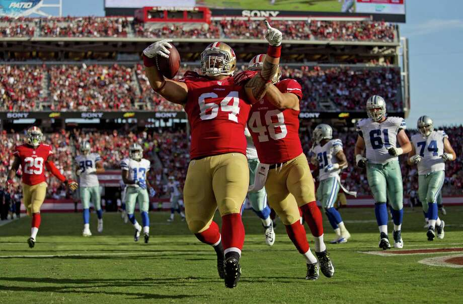 San Francisco tackle Mike Purcell celebrates his 37-yard interception return for a touchdown in the 49ers' win over the Cowboys. Photo: Brian Bahr / Getty Images / 2015 Getty Images