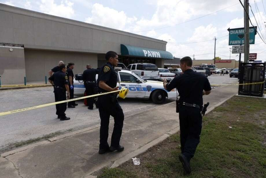 Multiple people were wounded in a shooting at a pawn shop in northeast Houston on Monday, Aug. 24, 2015. Photo: Cody Duty/Houston Chronicle