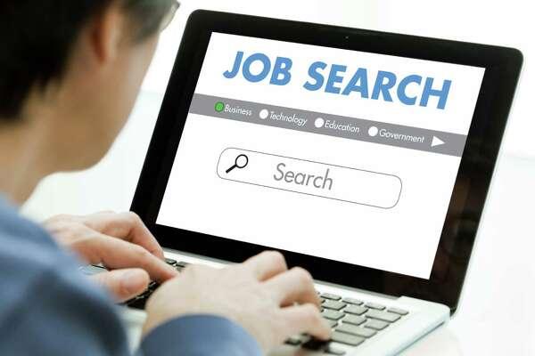 Unemployed Worker Seaching for Job Employment Using Computer Internet Website