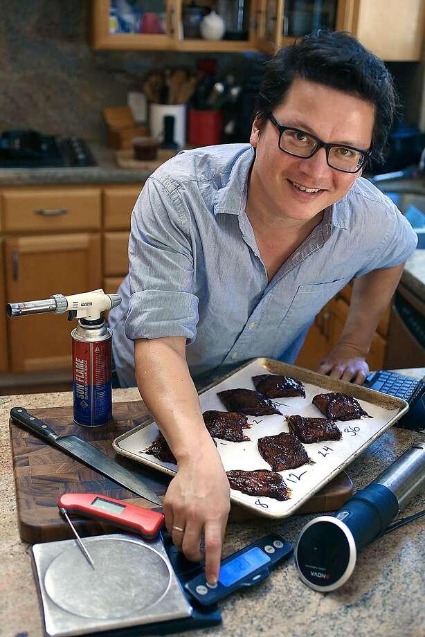 Food writer J. Kenji Lopez-Alt in his San Mateo home. Photo: Liz Hafalia, The Chronicle